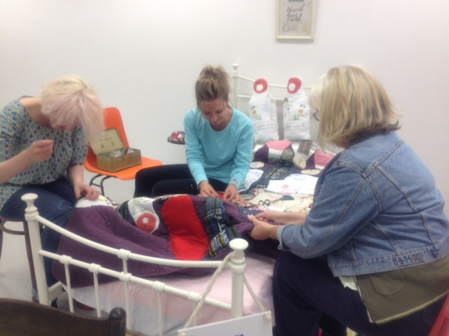 Donate a stitch to our Giving Quilt